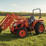 kioti tractor mowing a field